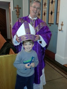 young parishioner with bishop